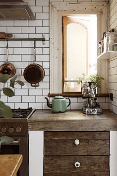 Natural wood and chippy paint in the kitchen.
