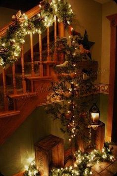 Rustic Christmas Decor. Love the boxes, garland, and lights on the floor.