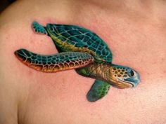 Colorful nice turtle tattoo on chest