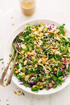 Asian style kale shaved brussel sprout salad with homemade ginger miso dressing. The best salad recipe to use up leftover turkey or chicken.