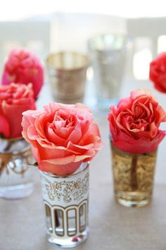 coral roses in Moroccan tea glasses. too too pretty!