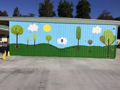 """Newhall schools welcome parent and community involvement to support student learning. Shown here is a new mural, part of a Meadows beautification project, painted by Girl Scout Troop 3512 led by Meadows alumni Indiana Hess, Dhanya Rodrigo, Stephanie Moreno, Abby Moreno, Maranda Laws, Nikki Noland and Alexa Lank. The quote says """"Wherever you go, no matter what the weather, always bring your own Sunshine"""" By Anthony J. D'Angelo. The mural was completed over the 2015 spring break."""