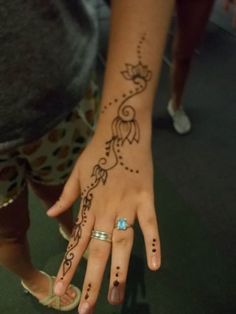 "Henna tattoos created by Crescent Moon Designs during the ""Groovy Henna Tattoos"" program at the Temecula Public Library during the Read to the Rhythm Summer Reading Program 2015."