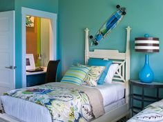 Fun and youthful, the kids bedroom at HGTV Smart Home 2013 celebrates life at the beach with tropical-print fabrics and a color palette drawn from the sea. Replace the skateboard on the wall with traditional artwork and dress the cottage-style twin poster beds in classic fabrics, and the space becomes ideal for adult guests.