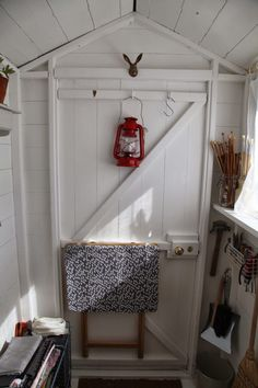 folding table + tie o n ironing board cover then hang it up till needed.junkaholique: in my workshop shed Ironing Pad, Workshop Shed, Knock On The Door, Shed Doors, My Building, Clothes Pegs, Artemis, Being A Landlord, Garage
