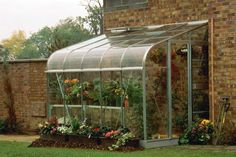 Glass Greenhouse With Brick Walls