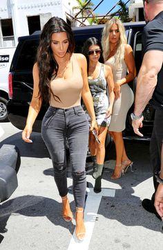 Nude body suit, j brand dark grey skinny jeans and heels. kim-kourtney-khloe-kardashian.jpg (2610×3996)