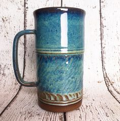 Beautiful handmade coffee mug. This mug makes great gift for any person. Hold 24 oz. All glazes are food, dishwater and microwave safe.