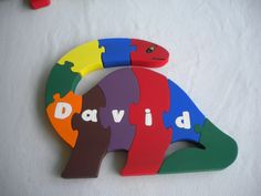 name puzzle,  dinosaur, hand painted, handmade puzzle, non toxic, large pieces, child's toy, educational toy, preschool puzzle, wood toy by WoodnThingsNY12534 on Etsy