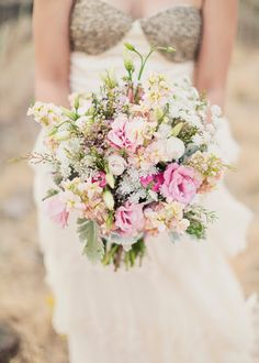 love the colours of this soft bouquet with the gold sequined top of the dress :)