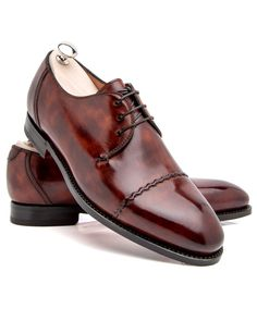 Bontoni Legno Scuro Violino Legno scuro loafer 3-eyelets Lace-up front Rounded toe Stacked stitched heel Leather lining and sole Padded insole Tonal top braid stitching Shoe trees included Color: legno scuro Handmade in Italy