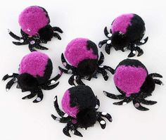 make 2 dark pompoms, glue on top of cardboard legs or use pipe cleaners