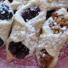 """Kolachky """"My father and grandparents were born in Czechoslovakia. I use to watch my grandmother make these small pastries at Christmas time and I couldn't wait to eat them when she was all done. I do hope you will enjoy this recipe as much as I do. You will need a large area to work."""""""