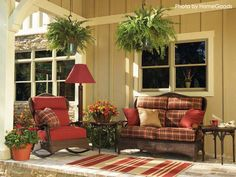 Your front porches make a great setting for lounging and relaxing outdoors. They went with wicker furniture and red cushions to match the traditional aroma. #porch #redfurniture