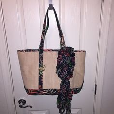 The Webster Miami Target Raffia Tote & Neck Scarf Worn for a weekend trip pristine condition  also including a matching scarf to wear in your neck hair or tie on bag ... Perfect for beach , As you can see I am fairly new to posh and I would love if you shared some of my listings and tagged some ppl you think would be interested in my items .... Don't forget to like the item to be notified when there is a price drop for closet clear out !!! Sorry no trades The webster Bags Totes