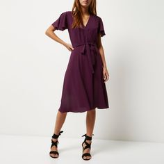 Checkout this Purple wrap midi dress from River Island