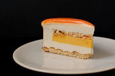 This coconut passion fruit entremet is a pastry masterpiece, not only thanks to its mirror glaze and perfect lines, but also due to its amazing taste! Passion Fruit Mousse, Passion Fruit Cake, Entremet Recipe, Coconut Mousse, Mango Mousse Cake, Cake Recipes, Dessert Recipes, Fancy Desserts, Melting Chocolate