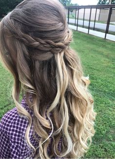 Half up/half down hair with messy braid and loose curls. Perfect for prom, wedding, or special occasions.