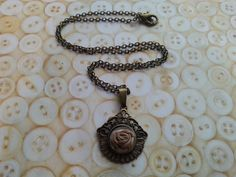 handmade vintage inspired shell button and ribbon by maxollieandme