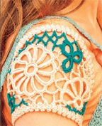 Here's a nifty pattern for crocheted sleeves by Natasha Robarge. This tutorial will help you create, assemble and join the motifs to the top of your choice
