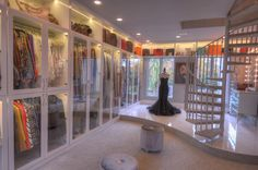 No, this is not an exclusive boutique - it is the 3,000 sq. ft., 3-story Master Wardrobe closet  in a mansion in The Woodlands, Texas. This is the 2nd floor...