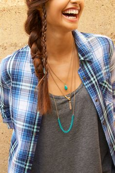 Three great layers, one amazing look. This three-row necklace with colorful aqua stones and sassy tassel is the perfect topping to everything from your plain white tee to your favorite maxi dress.