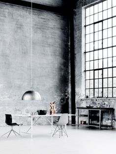 stark but stunning. concrete wall, black windows. Change the lamp to brass ...