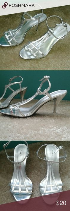 Fioni silver heals! Very nice, very cute on. Excellent condition, only worn once. Heal is about 3 inches. Would match anything. FIONI Clothing Shoes