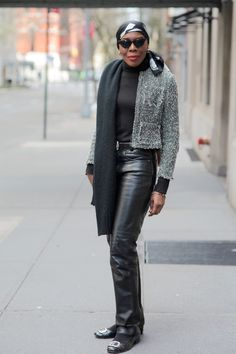 """Who says that once you reach """"a certain age"""" you can't rock leather pants?  Not this woman.  She looks great."""