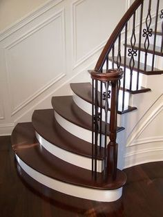 wrought iron balluster stairs with painted treads and risers