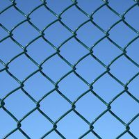 How to Fix the Bottom of a Chain Length Fence to Keep Dogs In