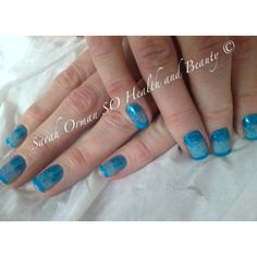 Azure wish CND Shellac with blue pigment additives to creat the ombré effect. Nail art design completed with a rockstar French tip using bright blue irresistible and Martha Stewart glitter. Encased in CNDs über glossy top coat keeping the design safe for 14 days with no Chipping, smudging or fade. The perfect summer manicure and pedicure. Sarah Orman @ SO Health and Beauty  Eastleigh, Winchester, Southampton 07429977674 Www.Sohealthandbeauty.Co.Uk Tweet: @sohealth_beauty Find us on Facebook