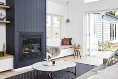 Real reno: California bungalow now bathed in sunshine - The Interiors Addict. Love the striking dark fireplace with vertical shiplap Home Fireplace, Living Room With Fireplace, Fireplace Design, Shiplap Fireplace, Fireplaces, Fireplace Kitchen, Bungalow Interiors, Bungalow Renovation, Arquitetura