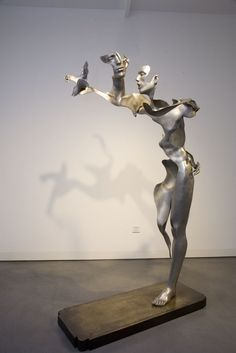 """Flash Memory #1"" (2009), by the Unmask Group (Liu Zhan, Kuang Jun, Tan Tianwei). Stainless steel, bronze base; dissolving figurative sculptures in the surrealist tradition."