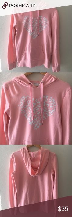 """VICTORIAS SECRET Hoodie Light Pink Victoria's Secret Hoodie  * Size M * Light pink with white heart design * Material: 60% Cotton 40% Polyester * Length: 25"""" * Bust: 18"""" * Sleeves: 22"""" * Excellent used condition.   *No trades/off-site transactions. Only respectful offers will be considered. Victoria's Secret Tops Sweatshirts & Hoodies"""