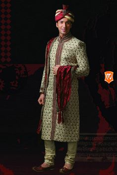 The Manyavar Royal Jaquard Sherwani :- This Sherwani weaved on lurex jaquard fabric is a wedding piece. The lavish look with stones studded in red, sequins, and thread work with keri designs and long intircate detail of red is the look of style in this wedding piece.  #Wedding #Sherwani #Manyavar #Ethnic Wear #Manyavar Wedding Wear #Indian Wedding Wear #Wedding Collection #Manyavar Sherwani