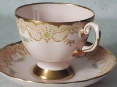 Oh so shabby chic teacup and saucer.  Pale pink vintage teacup and saucer.