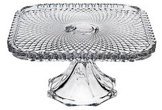 """Belmont Cake Plate, Clear, by Godinger. It's just 8"""", though. It reminds me of my favorite Spirograph pattern!"""