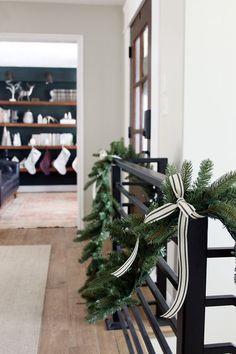 Christmas Around Our Home - christmas stair railing, garland on railing, metal stair railing with garland
