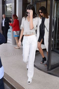 Kendall Jenner demonstrates the power of a fashionable fringe border around all items of clothing.