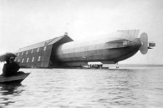 Blimp, Zeppelin No. 3, in shed, seen from water