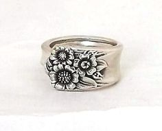 Spoon Ring April 1950 handmade from an upcycled silverware handle    Featured at the tip is a very detailed cluster of sunflowers  Florigraphy: