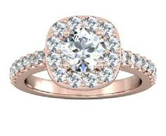 cushion cut set in rose gold with pave diamonds