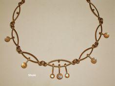 Necklace. 925 Silver wire1.2 mm'.7 pc' 8 mm'   Moonstone cabushon in silver bezel.