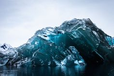 """""""An Iceberg Flipped Over, and Its Underside Is Breathtaking -- On vacation in Antarctica, filmmaker and photographer Alex Cornell captured an unusual sight"""" -- Click through to see more gorgeous photos."""