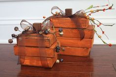 Super easy 2x4 pumpkins.  The sprigs on top sure dress them up! painted orange & distressed