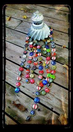 Recycled wind chimes made from bottle caps and jello molds.