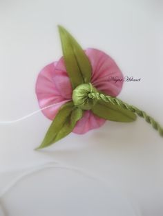 Tutorial: assembling a ribbonwork rose with calyx and cord stem, by Nigar Hikmet. Note the stem, which is cord made from twisted ribbon. Part 9
