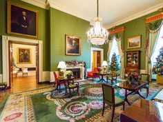 Eight-foot-tall Christmas trees stand in front of each window in the Green Room. The trees are decorated with round disc ornaments accented with red poppies, orange and red felt flowers and faux sugared fruits. Around the room, guests will discover an abundance of lush holiday foliage.