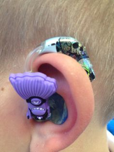 Evil minion Tubetastic Pimp on another lads ear with a skull nail foil on his oticon hearing aids done at PDDCS winter party